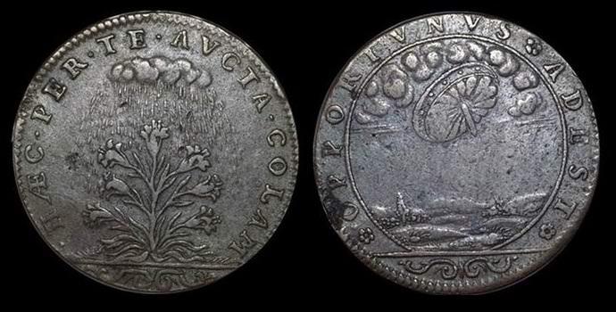 На старинной французской монете обнаружили летающую тарелку