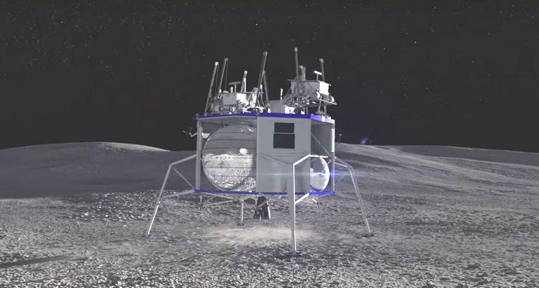"""Джефф Безос демонстрирует лунный посадочный модуль в натуральную величину"""" />"""