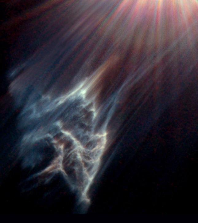 Свет звезды осветил приближающуюся к ней с большой скоростью туманность