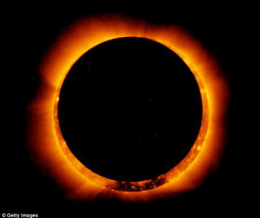Sun spots are seen as the moon moves into a full eclipse position seen in the U.S. in May: Late summer will see the Sun reach the maximum point of its 11-year cycle, resulting in an increase in such activity
